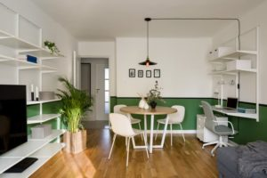 a studio apartment efficiently decorated to look larger