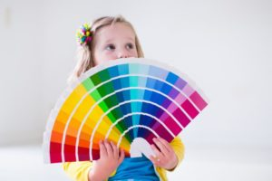 child deciding on colors for painting a child's room